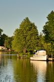 River Motorboat And Trees. A natural landscape or vista royalty free stock photography