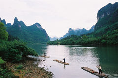 River and the mountain. There is some boats in the river, it is spring, the mountain is green color. location is China Royalty Free Stock Photography