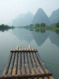 River, Mountain And Bamboo Raft Royalty Free Stock Photography
