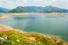 River and mountain backside of Khundanprakanchon dam, Nakhon Nay Stock Photo