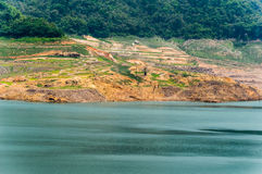 River and mountain backside of Khundanprakanchon dam, Nakhon Nay Royalty Free Stock Image