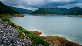 River and mountain backside of Khundanprakanchon dam. Royalty Free Stock Images