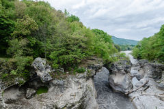 River in the mountain. The river is sandwiched in the rocks Royalty Free Stock Photography