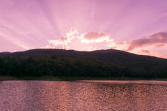 River Mountain sunshine and purple sky in evening time Royalty Free Stock Images