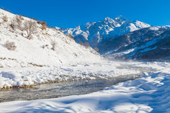 River in a mountain valley at winter Stock Photos