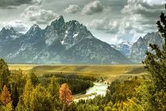 River and mountains. Scenic view of Snake river with snow capped mountains in background, Grand Teton National Park, Wyoming, U.S.A Stock Photos