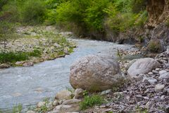 The river in mountains, big boulder Royalty Free Stock Images