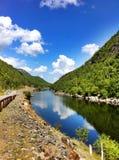 River, mountains, blue sky Stock Photos
