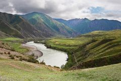 River, mountains and clouds. Stock Images