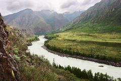 River, mountains and clouds. Stock Image