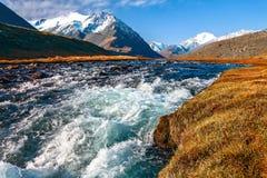 River, mountains, grass, sky Stock Photo
