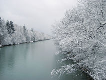 A river in the mountains with snow along the banks Stock Images