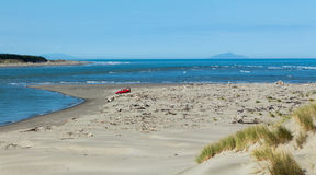 River Mouth. Manawatu river flowing out to sea. With a red car too Royalty Free Stock Images