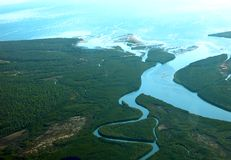 River mouth delta. Aerial view of river winding into the ocean Stock Photo
