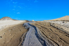 River of Mud. At Paclele Mari, in Buzau county, Romania, the volcanoes do not erupt lava, but mud. The mud erupting from these miniature volcanoes sometimes stock photography