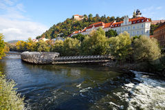 River Mur with the artificial floating platform Mur island Murinsel in the middle and old buildings on the river bank. Royalty Free Stock Photo