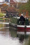 River narrow boat. Narrow boat on river with houses Royalty Free Stock Photos