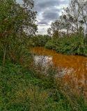 River of the natural setting of Clot. With sediment laden water after heavy rains royalty free stock photo
