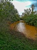 River of the natural setting of Clot. With sediment laden water after heavy rains stock photos
