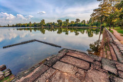 River near ancient buddhist khmer temple in Angkor Wat complex Stock Photos