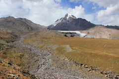 The river near Kazbek Mount (Georgia). Mount Kazbek (Mkinvartsveri) is a dormant stratovolcano and one of the major mountains of the Caucasus located in the royalty free stock photo