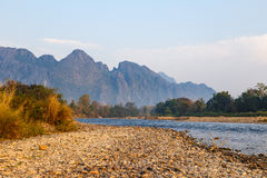River near mountain in Vangvieng Stock Photos