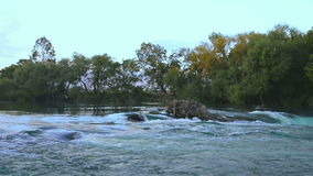 River near waterfall. Shot is taken in the end of summer day on Manavgat river near waterfall stock video footage