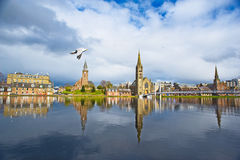River Ness at high tide. The River Ness with reflections of three churches and the Greig Street Bridge Stock Photography