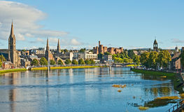 River Ness at high tide. With many churches and the historic Castle visible along the river banks Stock Photo