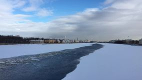 The river Neva is covered with ice and snow stock footage