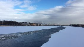 The river Neva is covered with ice and snow stock video footage