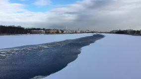 The river Neva is covered with ice and snow stock video