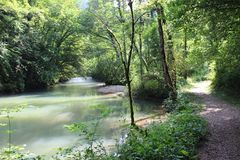 River next to a trai in the Jura, France royalty free stock images