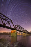 River Through the Night. A long exposure view of the night sky creating startrails Royalty Free Stock Photos