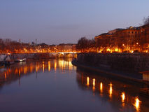 River by night. Tiber by night. Rome is always wondereful especially by night. Reflections of the lights on the river's water stock photos