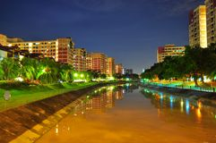 A river by night at Pasir Ris, Singapore. A river surrounded by public housing buildings in Pasir Ris, Singapore, with light reflection on the river Royalty Free Stock Image