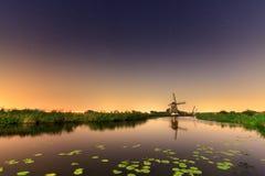River night windmill Stock Photography