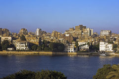 River Nile and colonial mansions in foreground Gezira island Cairo. Egypt Stock Image