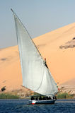 River Nile felucca. In front of sand dune, Luxor, Aswan, Egypt Stock Photos