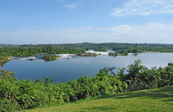 River Nile scenery near Jinja in Uganda. Sunny pictorial waterside scenery showing the River Nile near Jinja in Uganda (Africa Royalty Free Stock Photos