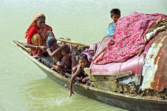 River nomads on their poor houseboat, Bangladesh. Bangladesh, CHARKAJAL island in the Bay of Bengal: Group portrait or family portrait of Bengali, Bangladeshi Royalty Free Stock Image