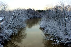 The river not frozen at cold snow day. Snow day makes art comes true in Washington DC royalty free stock images