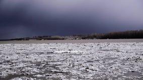River Ob. Ice drift into Siberia. Ice drift on the river in Siberia, ice floe motion, dark sky stock video footage