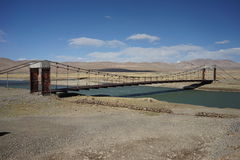River and the obsolete bridge in Tibet Stock Photos