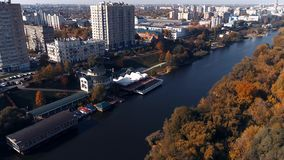 River in October 05. River in October, Shooting from a quadrocopter. The colors of autumn, the river tram goes along the river. Beautiful pedestrian bridge stock video