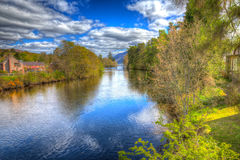 River Oich Fort Augustus Scotland UK next to Loch Ness with bridge in colourful HDR Royalty Free Stock Photos