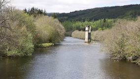 River Oich Fort Augustus Scotland UK Scottish Highlands popular tourist village next to Loch Ness with bridge tower stock footage
