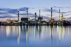 River and oil refinery factory with reflection Stock Photos