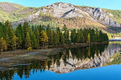 The river Oka and Sayan Mountains reflection Stock Photos