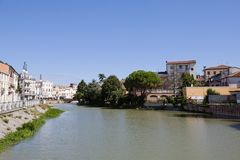 River and old buildings, Italy Stock Images